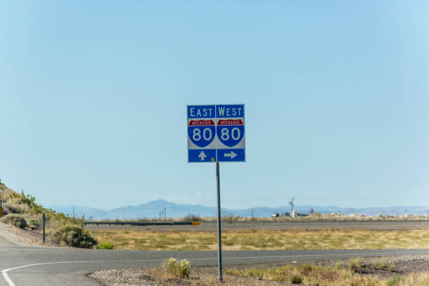 interstate 80 traffic sign on highway between utah and nevada usa america - west direction stock pictures, royalty-free photos & images