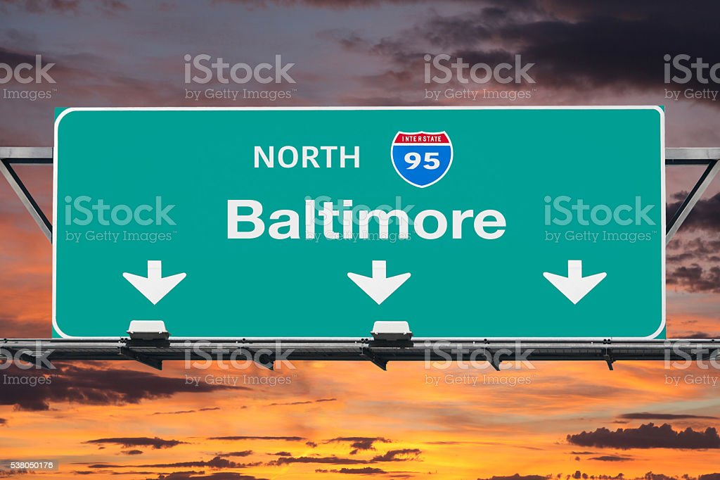 Interstate 95 to Baltimore Highway Sign with Sunrise Sky stock photo