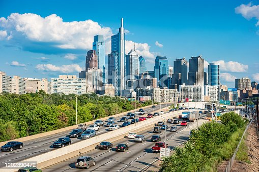 Stock photograph of downtown Philadelphia Pennsylvania USA with traffic on interstate I-76 on a sunny day.