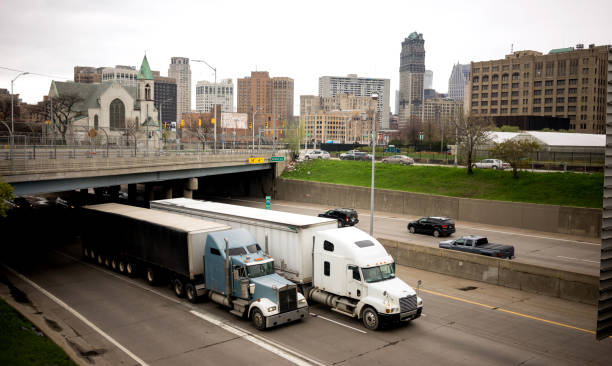 Interstate Highway Traffic Flows Arouund Detroit Michigan Metro Area Big Rigs frequent the highways in and around Detroit Michigan in a horizontal composition detroit michigan stock pictures, royalty-free photos & images