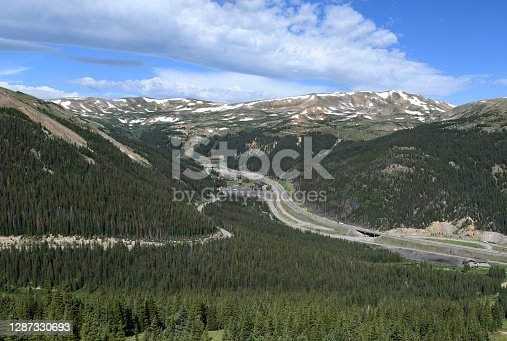 At the elevation of 11,013 ft (3,357 m), interstate I-70 disappears inside the 1.697 mi (2.73 km) long Eisenhower Tunnel, Colorado.