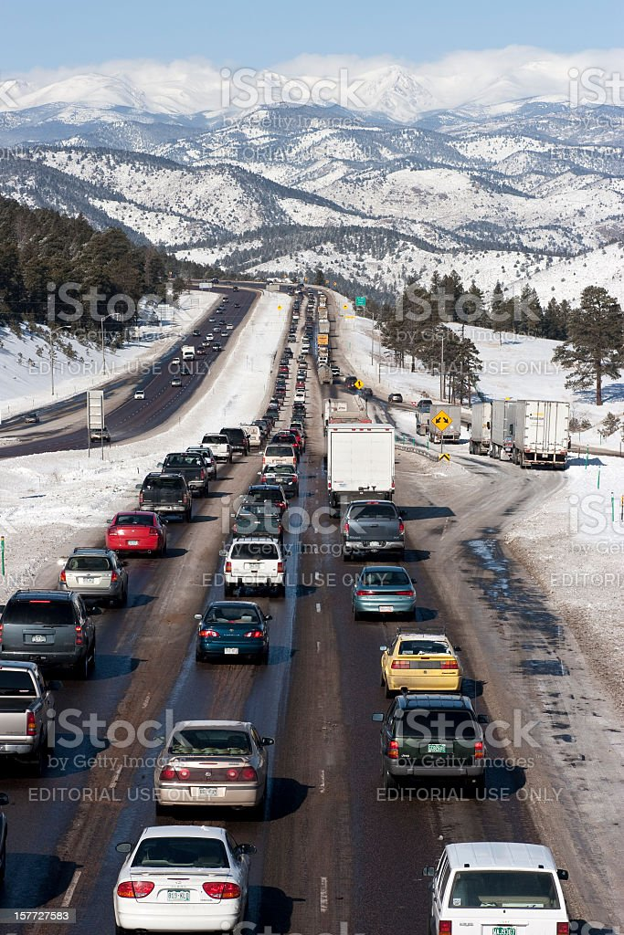 Interstate-70 highway traffic and Rocky Mountains Colorado vertical stock photo