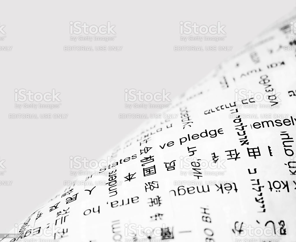 Intertwined text in several languages stock photo