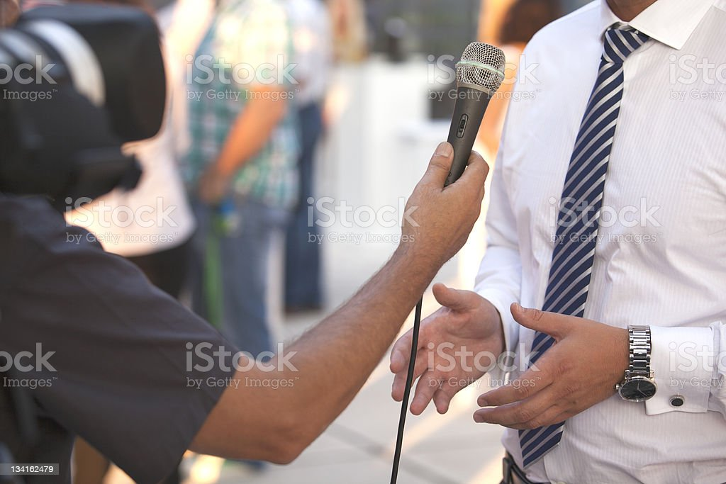 Interview between two men on microphone royalty-free stock photo