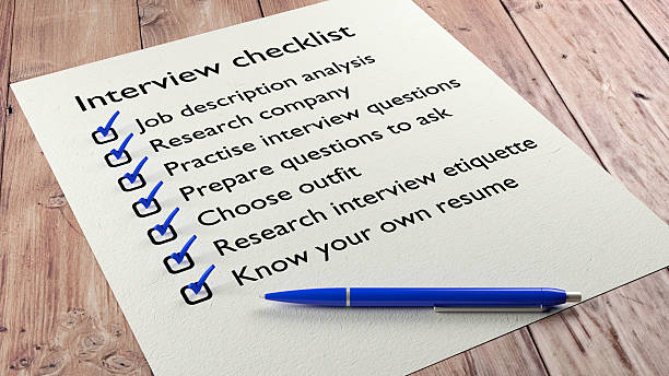 Interview checklist blue pen on wooden table stock photo
