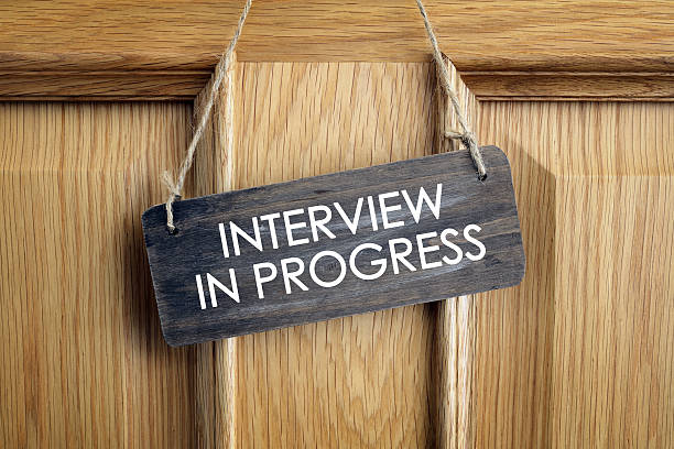 Interview in progress sign on office door - foto de acervo