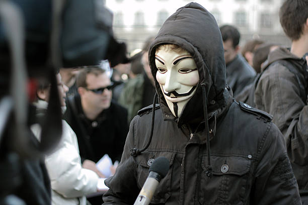 interview with anonymous group member - guy fawkes mask stock photos and pictures