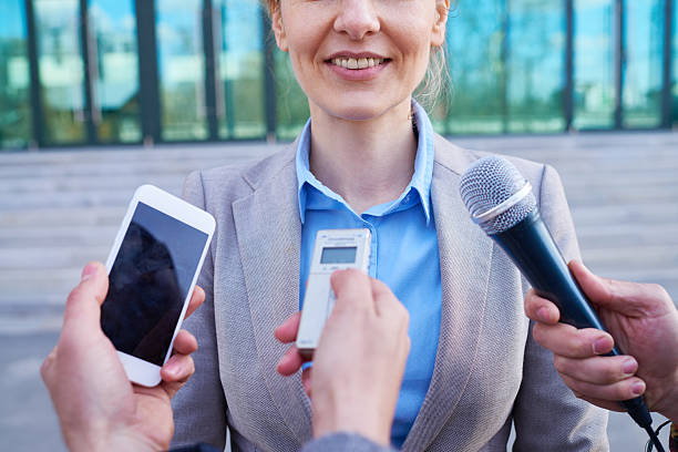 interviewing outdoors - dictaphone stock pictures, royalty-free photos & images