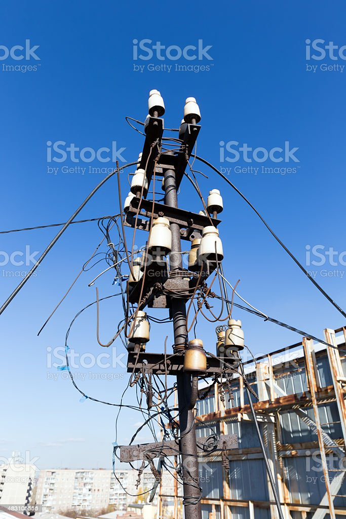 Interweaving street electrical wires on a background of blue sky stock photo