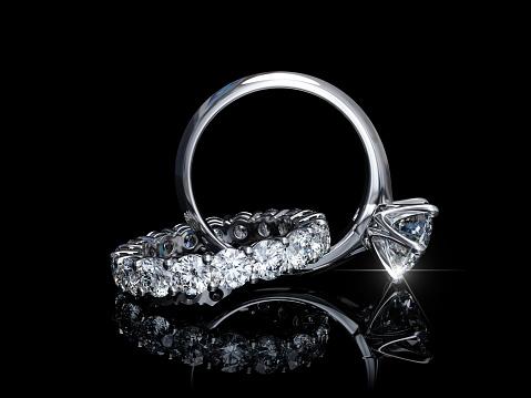 Interwoven Diamond Engagement Ring Wedding Ring On Black Background - zdjęcia stockowe i więcej obrazów Bez ludzi