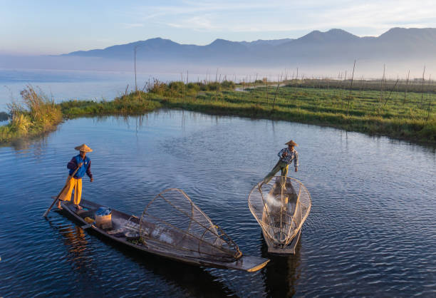 Intha fishermen in early morning on Inle Lake stock photo