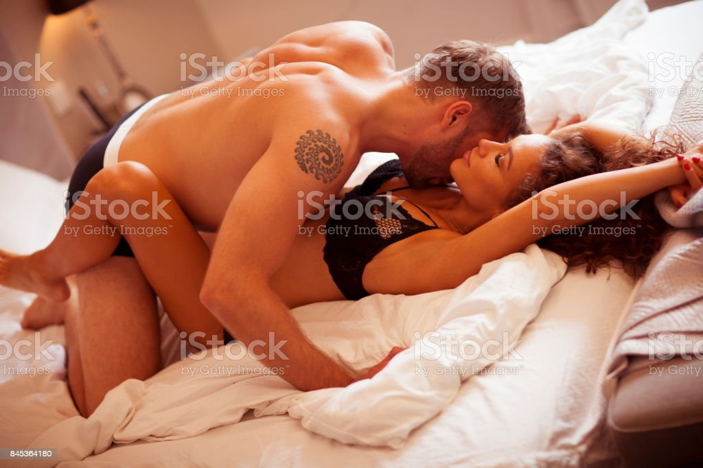 Intimate couple in bed. stock photo