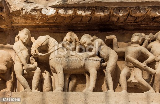 istock Intimate life of ancient people, Khajuraho temple, India. UNESCO site 623110446