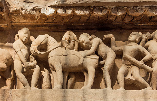 Intimate life of ancient people, Khajuraho temple, India. UNESCO site stock photo