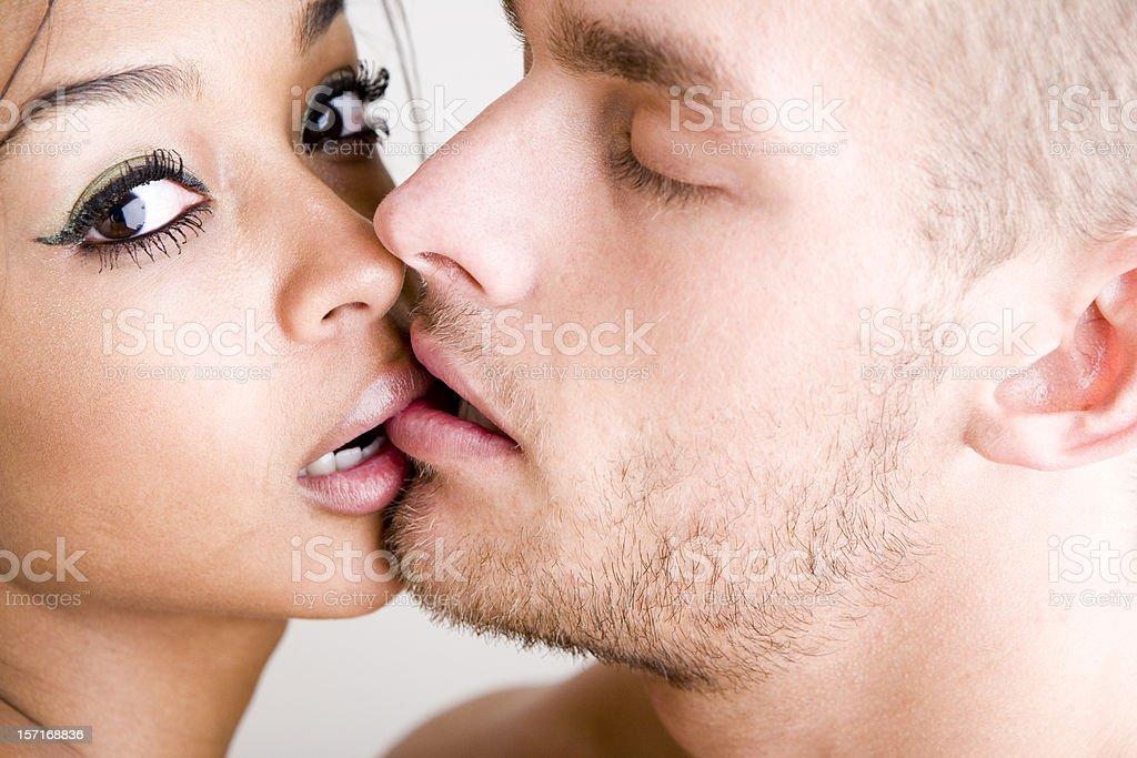 Intimate moment between a pair of kissing young lovers stock photo