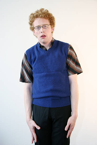 Intimidated nerd looking daft stock photo