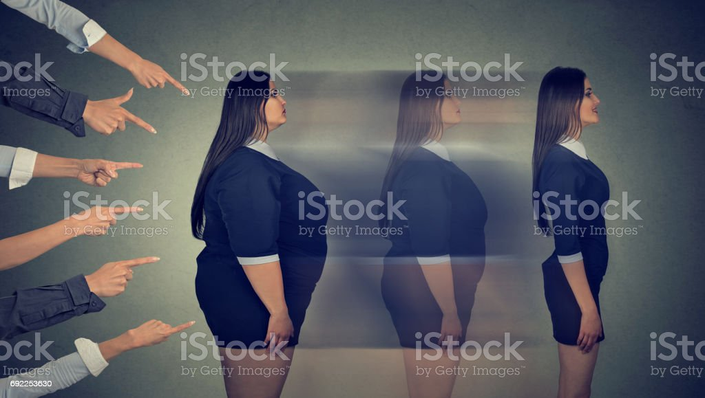 Intimidated obese woman transforms her body through strict diet becomes a slim girl stock photo