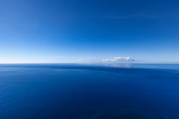 into the blue, ocean seascape with lonely cloud - atlantic ocean stock pictures, royalty-free photos & images