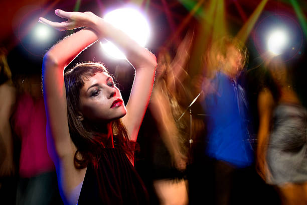 Intoxicated Female in a Nightclub stock photo