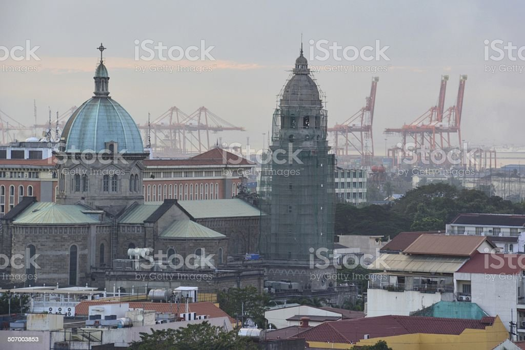 Intramuros district at Manila port and cathedral at sunset stock photo
