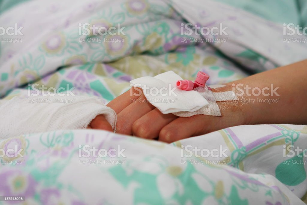 Intravenous catheter....patient after surgery royalty-free stock photo