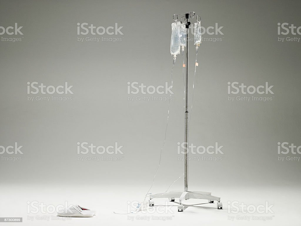 Intravenous drip and slippers stock photo