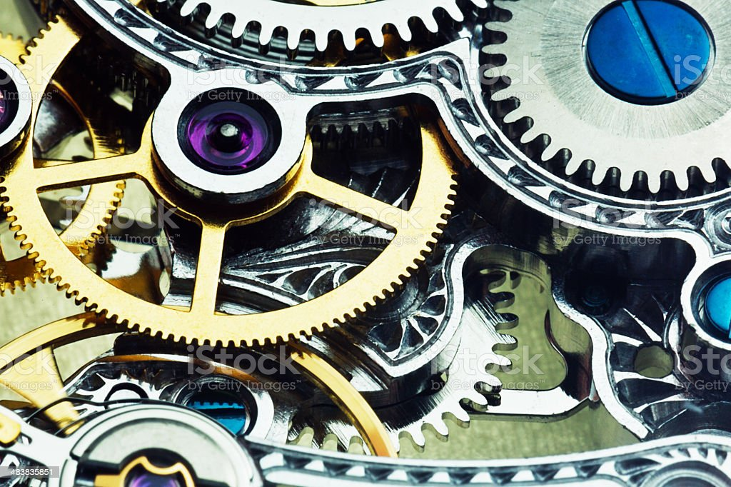 Intricate clockwork mechanism of skeleton watch seen in close up stock photo