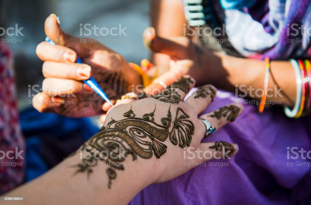 Intricate Forearm And Hand Henna Tattoos in India stock photo