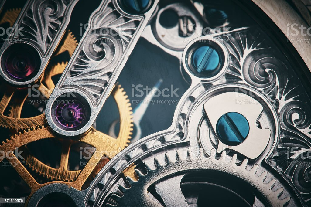 Intricate inner workings of a clockwork watch stock photo