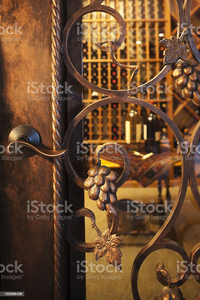 Intricate wine cellar door. stock photo