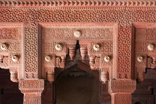 Intricately carved red stone gateway