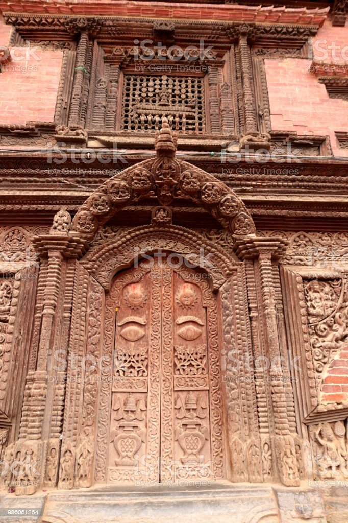 Intricately carved wooden door and details in Bhakrapur durbar square, Kathmandu, Nepal stock photo