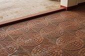 Intricately patterned Terracota floor tiled veranda