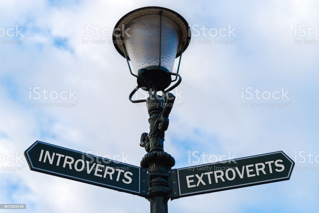 Introverts versus Extroverts directional signs stock photo