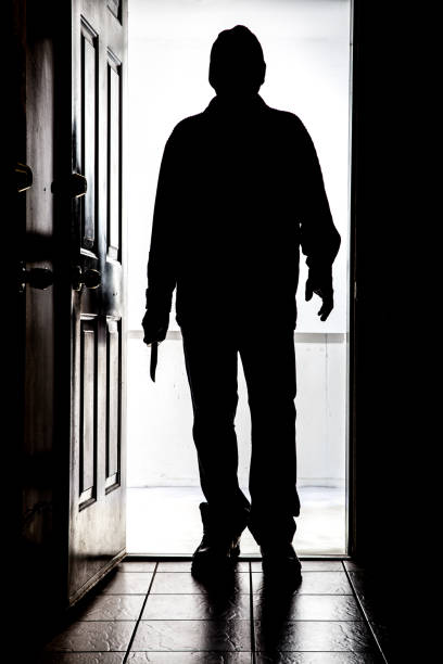 intruder at door, in silhouette with buck knife - killer stock pictures, royalty-free photos & images
