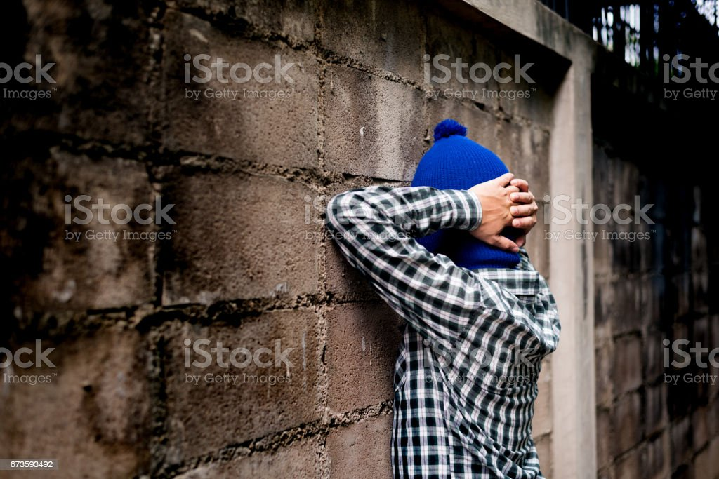 intrusion concept. a burglar show hands up in arrested. lighting effect. stock photo