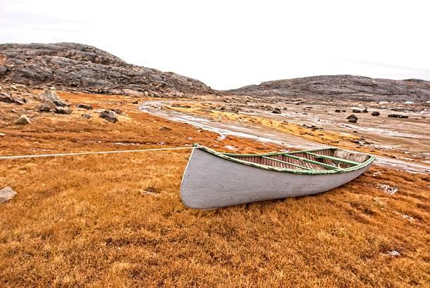 Inuit boat pulled on shore, Baffin Island, Nunavut, Canada. stock photo