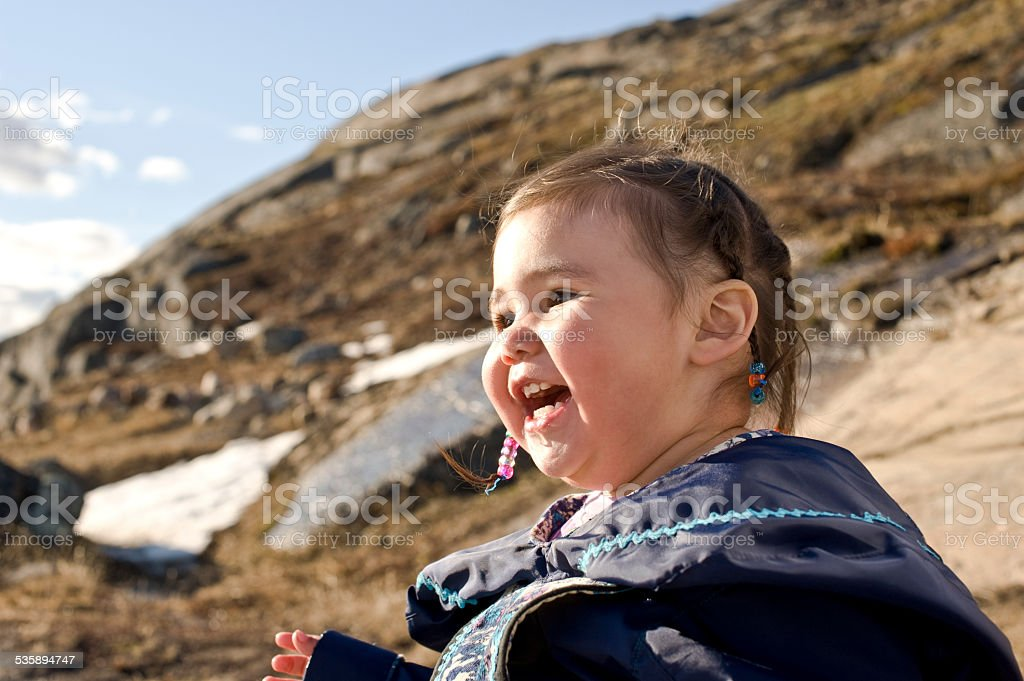 Inuit Child in the Snow, Baffin Island, Nunavut, Canada. stock photo