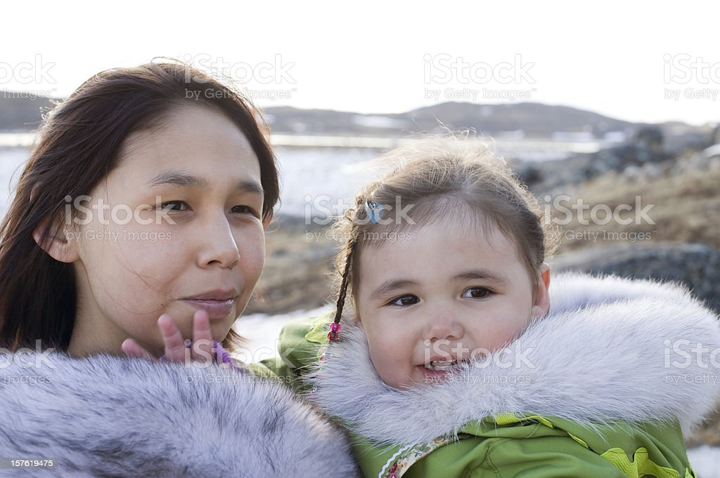 Inuit Mother and Daughter Baffin Island, Nunavut. stock photo