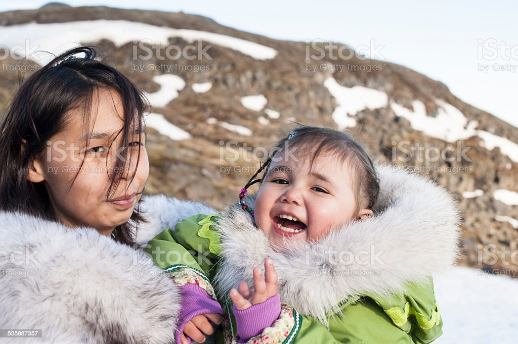 Inuit Mother and Daughter on Baffin Island, Nunavut, Canada. stock photo