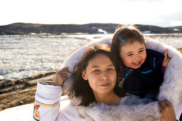 Inuit Mother and Daughter Traditional Dress Baffin Island Nunavut stock photo