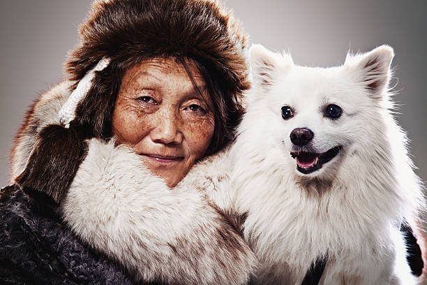 Inuit Woman and dog stock photo