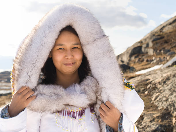 Inuit woman in traditional dress on Baffin Island stock photo