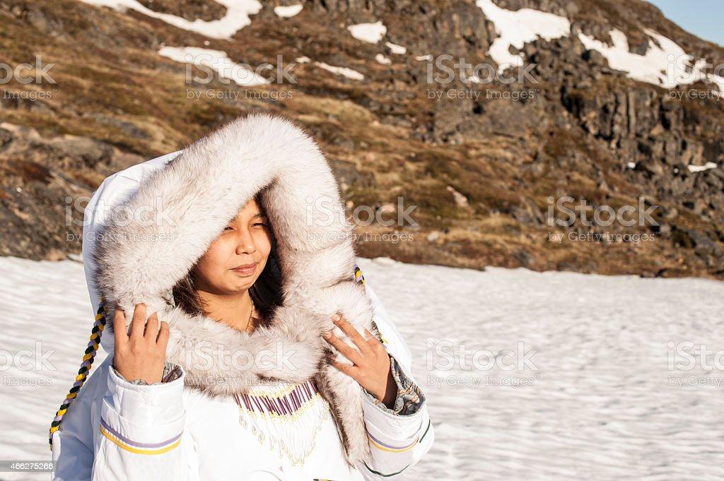Inuit Woman on the Tundra of Baffin Island, Nunavut, Canada. stock photo