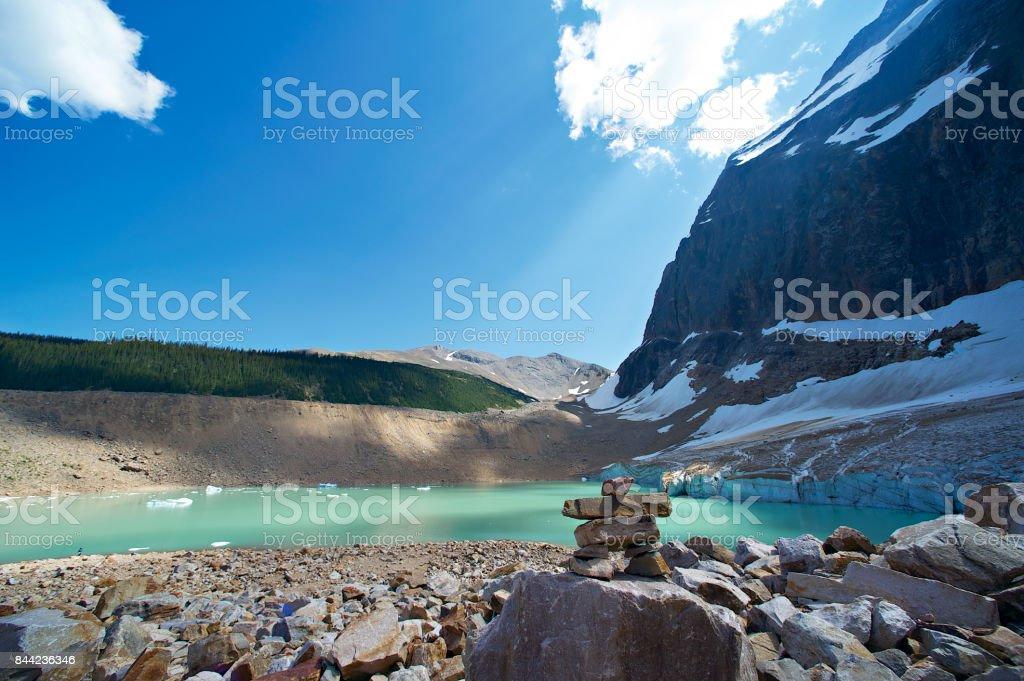 Inukshuk at a Glacial Lake stock photo