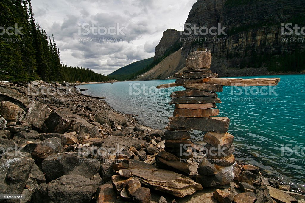 Inukshuk at a Lake in the Canadian Rockies stock photo