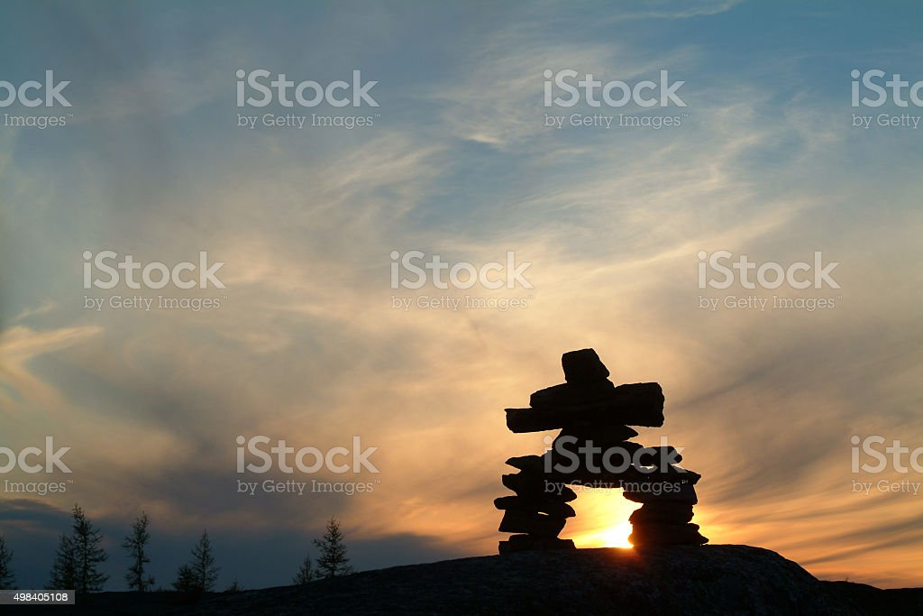 Inukshuk at dusk in Nunavik stock photo
