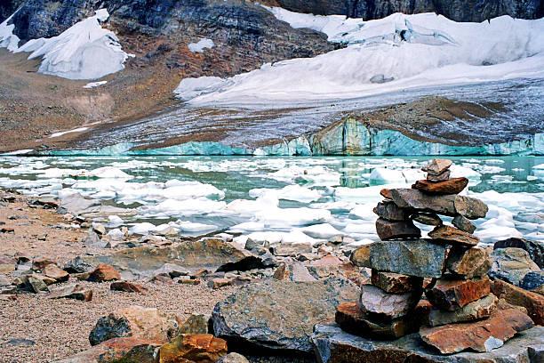 Inukshuk at glacial lake stock photo