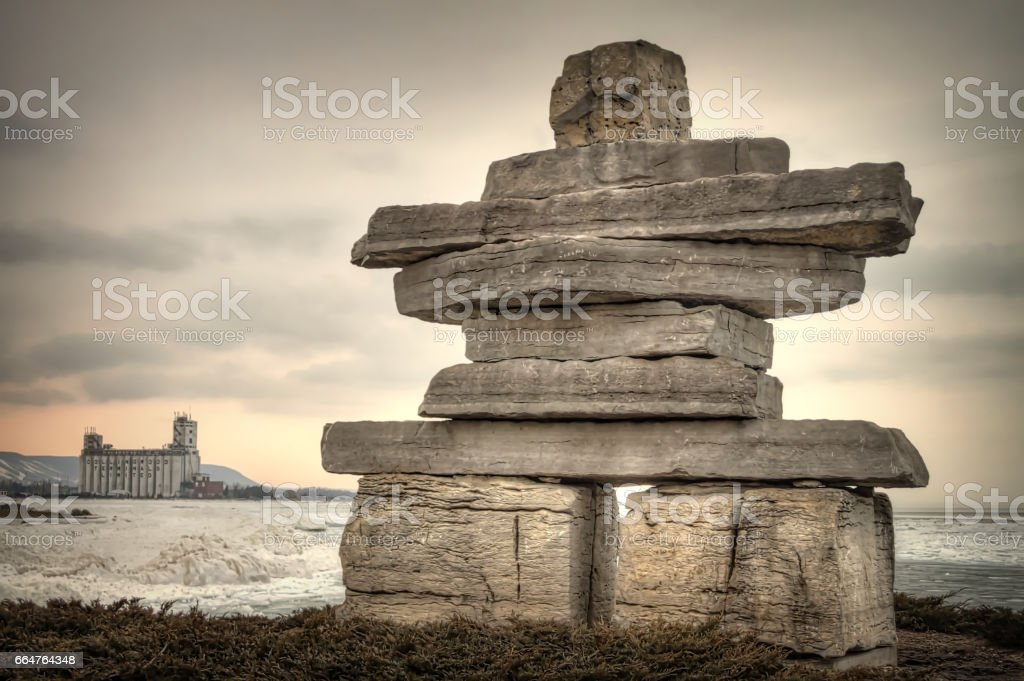 Inukshuk by the lake in winter stock photo