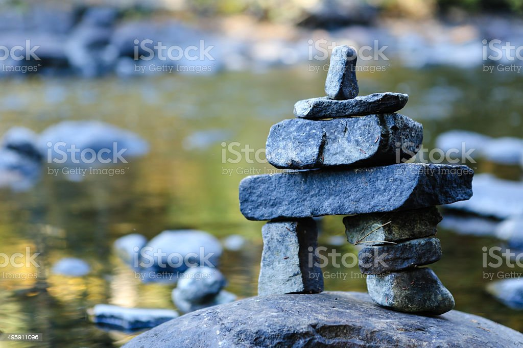 inukshuk on river stock photo